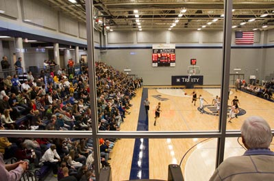 Crowd of people watching a basketball game in the DeVos Gymnasium