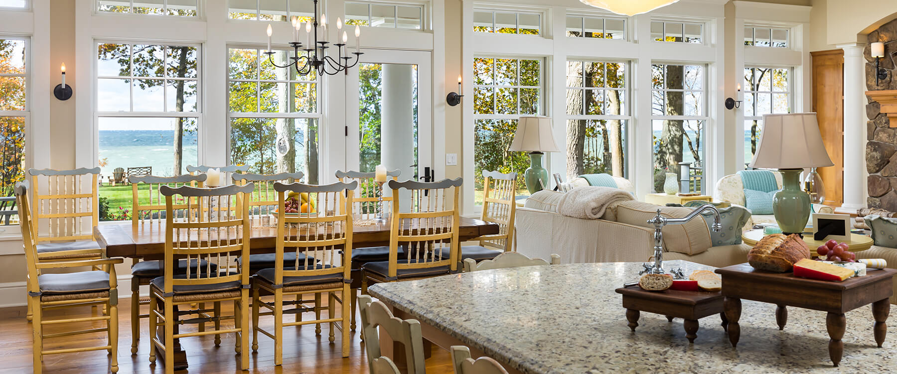 Kitchen and dining at shingle style cottage